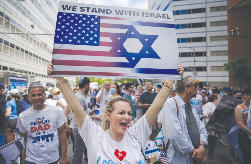PRO-ISRAEL DEMONSTRATORS attend a rally denouncing antisemitism and antisemitic attacks, in Manhattan, last month.  (credit: ED JONES/AFP/GETTY IMAGES/TNS)