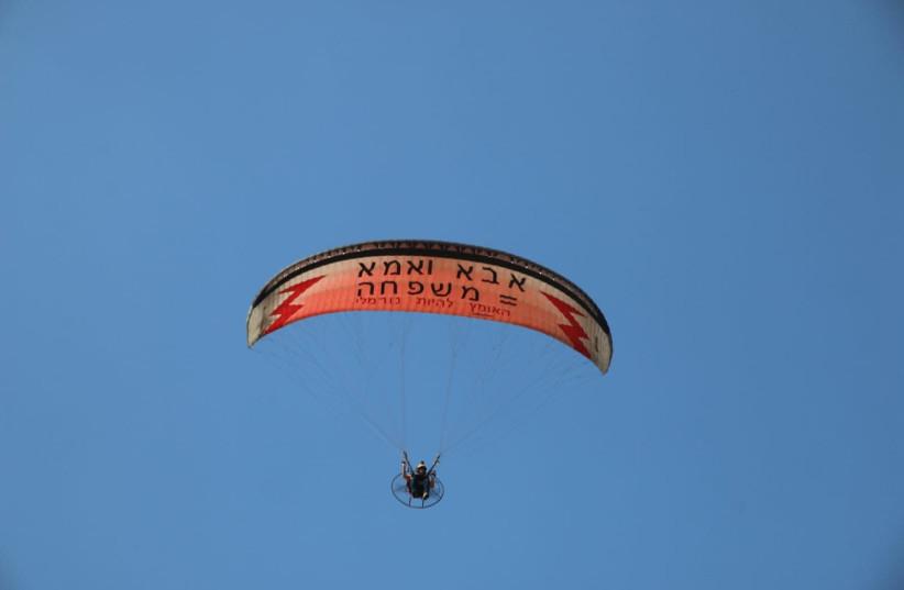 Tnuat Hazon's paraglider with sign opposing Tel Aviv Pride Parade. (photo credit: TNUAT HAZON)