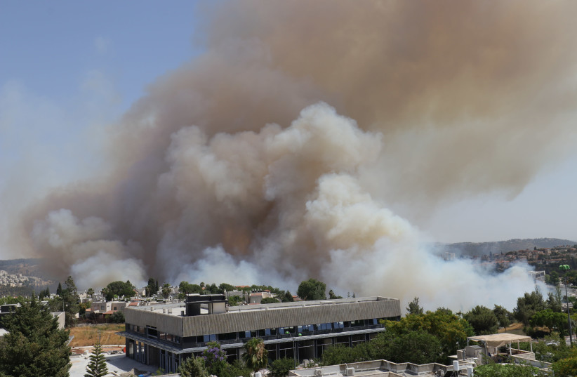 A fire that broke out near Mevesseret Zion. (photo credit: CARRIE HART)