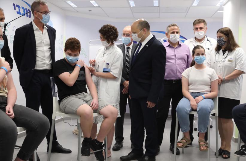 Prime Minister Naftali Bennett visiting a vaccination center in Holon, June 29, 2021.  (credit: MARC ISRAEL SELLEM/THE JERUSALEM POST)
