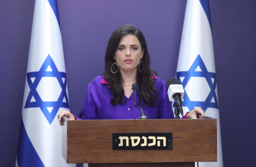 Interior Minister Ayelet Shaked is seen speaking at the Knesset, on July 5, 2021. (credit: MARC ISRAEL SELLEM/THE JERUSALEM POST)