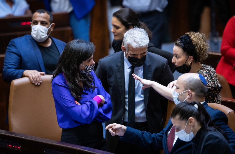 Prime Minister Naftali Bennett and Foreign Minister Yair Lapid with Interior Minister Ayelet Shaked, Transport Minister Merav Michaeli, and Yamina MK Idit Silman ahead of the Citizenship Law vote, July 6, 2021 (credit: YONATAN SINDEL/FLASH 90)