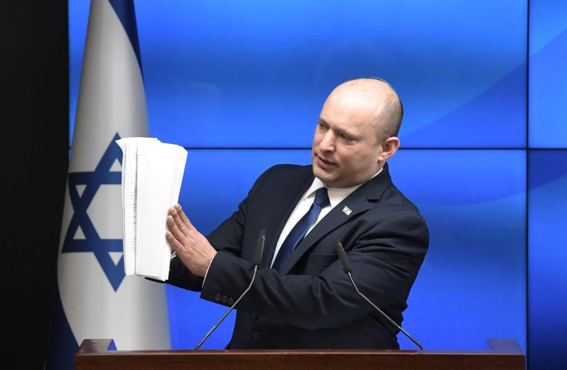 Prime Minister Naftali Bennett is seen gesturing at paper, on July 6, 2021. (photo credit: KOBI GIDEON/GPO)