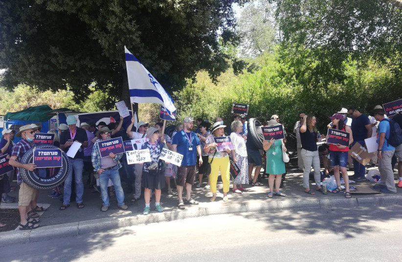 Israeli tour guides are seen protesting outside the Knesset as low tourism and no government benefits puts them in crisis, on July 6, 2021. (credit: ZEV STUB)