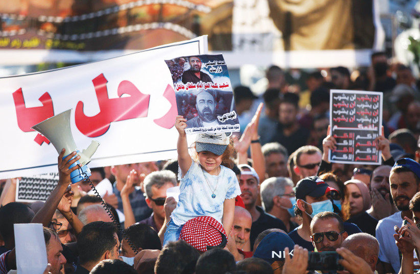 PALESTINIANS IN Ramallah attend a protest last week over the death of human rights activist Nizar Banat. (credit: FLASH90)