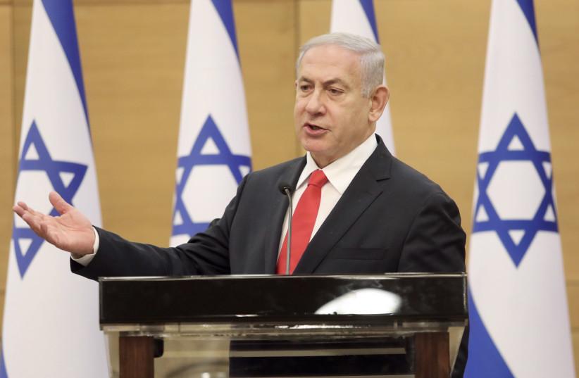 Opposition leader Benjamin Netanyahu is seen at the Knesset, on July 12, 2021. (credit: MARC ISRAEL SELLEM/THE JERUSALEM POST)