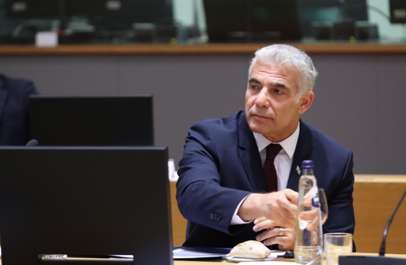 Israel's Foreign Minister Yair Lapid is seen speaking to European Union foreign ministers in Brussels, Belgium, on July 12, 2021. (photo credit: EUROPEAN UNION)