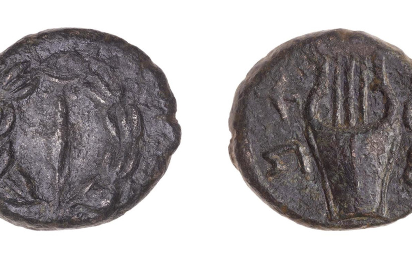 The 2,000-year-old coins that date back to the period of the Jewish revolts against the Romans, July 13, 2021. (photo credit: TAL ROGOVSKY)