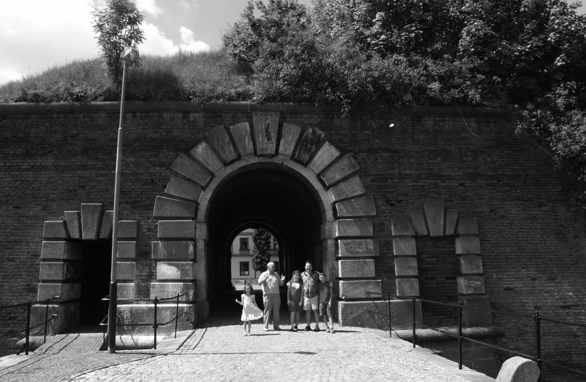 THE WRITER'S son and family visited the city of Terezin, at one of the security gates in the fortification walls the Nazis used as a ready-made concentration camp. (credit: COURTESY CHARLES TICHO)