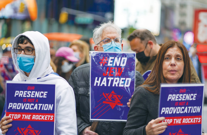 PEOPLE DEMONSTRATE against antisemitism and in support of Israel at a rally in New York City's Times Square in May. (photo credit: REUTERS/DAVID 'DEE' DELGADO)