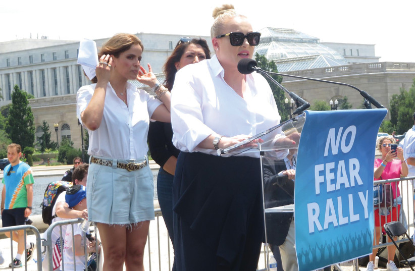 MEGHAN MCCAIN speaks at Sunday's rally against antisemitism, as Israeli actress Noa Tishby and Arizona State Rep. Alma Hernandez look on at the US Capitol in Washington. (photo credit: RON KAMPEAS)
