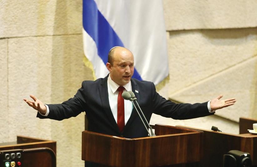 PRIME MINISTER Naftali Bennett speaks in the Knesset this week. (photo credit: MARC ISRAEL SELLEM/THE JERUSALEM POST)