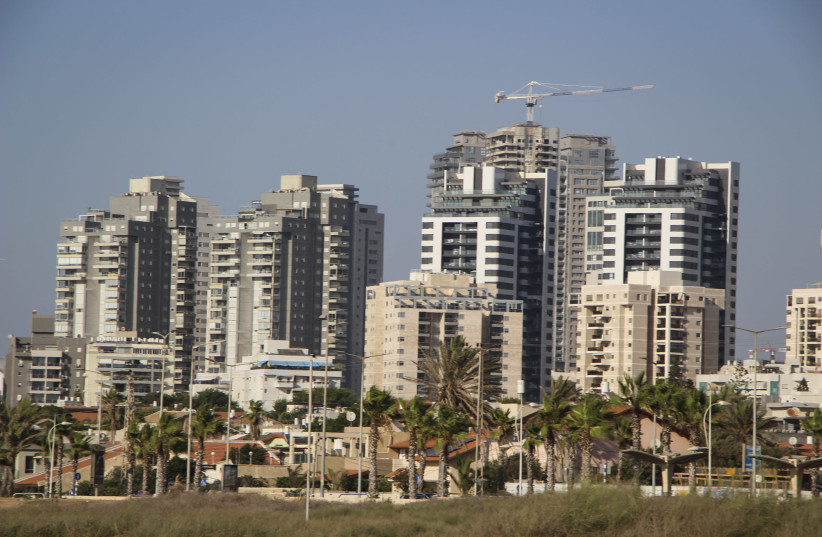 View of new high-rise apartment buildings next to older small homes, in the southern Israeli city of Ashdod (credit: GERSHON ELINSON/FLASH90)