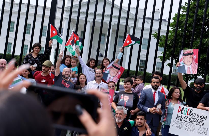Supporters of Jordan's King Abdullah II gather ahead of his meeting with US President Joe Biden in Washington (photo credit: REUTERS/JONATHAN ERNST)