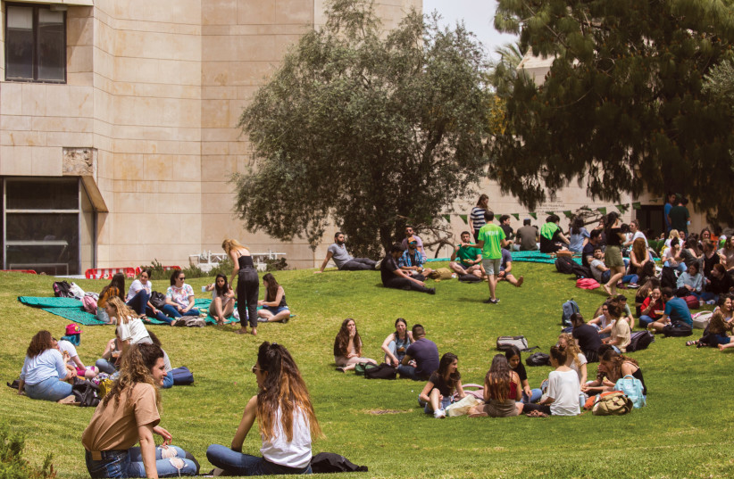 Students at the Mount Scopus campus of the Hebrew University of Jerusalem earlier this year. (credit: OLIVIER FITOUSSI/FLASH90)