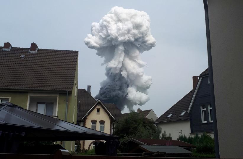 Smoke billows following an explosion in Wiesdorf, Leverkusen, Germany July 27, 2021 (photo credit: REUTERS / ANNA FROSS)