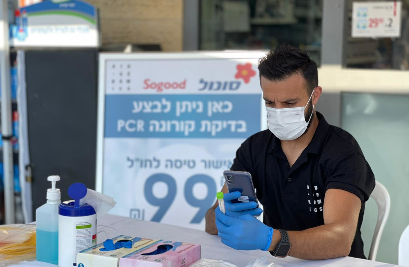 Coronavirus PCR tests being performed at Sonol gas stations. (photo credit: Courtesy)