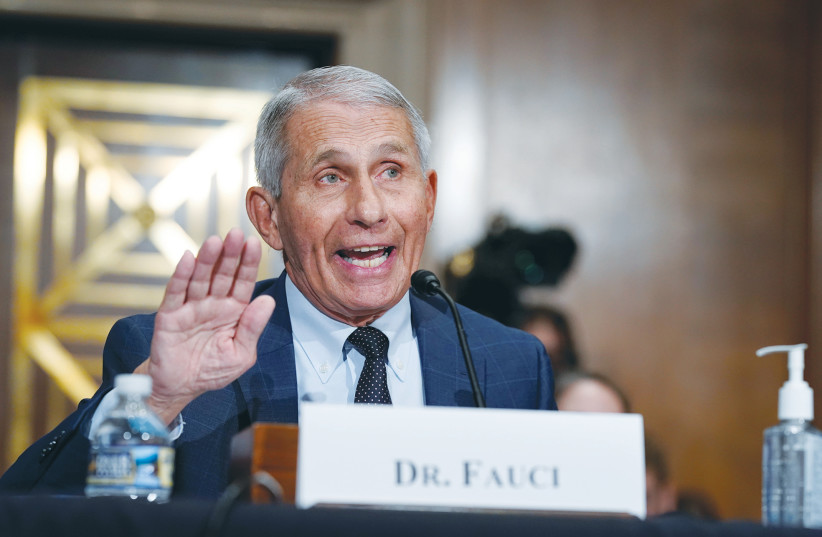 TOP INFECTIVE DISEASE EXPERT, dr.  Anthony Fauci, responds to accusations by Sen. Rand Paul during testimony before the U.S. Senate Committee on Health, Education, Labor and Pensions on Capitol Hill in Washington earlier this month.  (Credit: J. SCOTT APPLEWHITE / REUTERS)