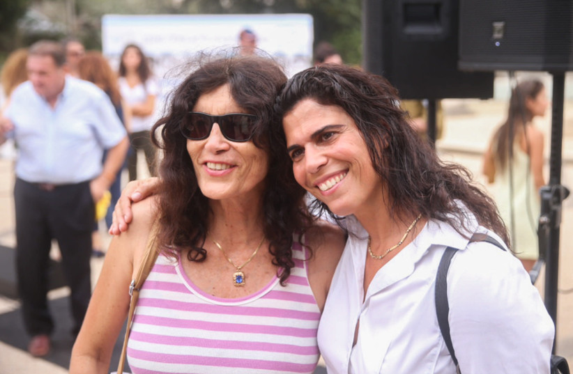 Former Israeli judoka Yael Arad (R) poses for a picture ouside the 43rd memorial service to the eleven Israeli Olympic team members, who were taken hostage and was murdered at the Munich Olympics in 1972 in Tel Aviv on September 9, 2015.  (photo credit: FLASH90)