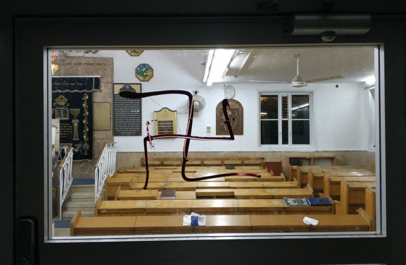 Swastika scrawled on synagogue in Bnei Brak, July 2021 (photo credit: ISRAEL POLICE)
