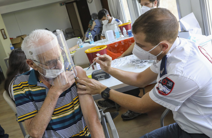 Third vaccine doses being administered at the Amigdor Retirement Residence by Magen David Adom (MDA), Jerusalem, August 5, 2021.  (credit: MARC ISRAEL SELLEM)