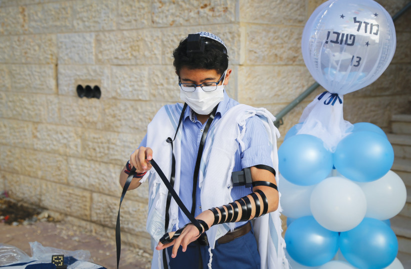 HOW WILL the boy whose Masorti bar mitzvah was disrupted remember the day he became a man? (Illustrative) (photo credit: GERSHON ELINSON/FLASH90)