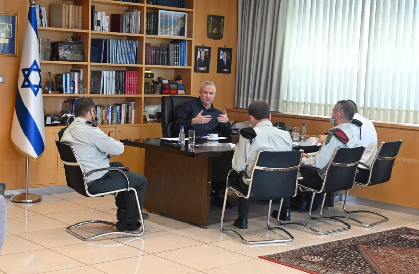 Defense Minister Benny Gantz conducting a security meeting with IDF Chief of Staff Lt.-Gen. Aviv Kohavi and others in the Kirya military headquarters in Tel Aviv, August 6, 2021.  (photographer: DEFENSE MINISTRY)