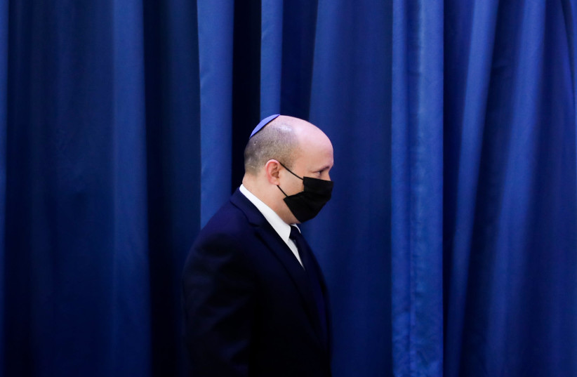 Israeli Prime Minister Naftali Bennett speaks with Foreign Minister Yair Lapid during a cabinet meeting at the Foreign Ministry in Jerusalem on August 8, 2021. (credit: OHAD TZVEIGENBERG/POOL)