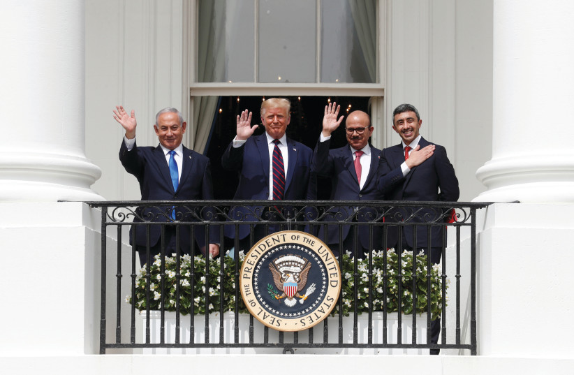 AL ZAYANI, NETANYAHU, Trump and bin Zayed participate in the signing of the Abraham Accords. (credit: TOM BRENNER/REUTERS)