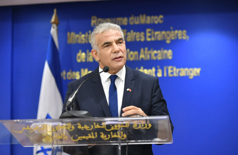 Foreign Minister Yair Lapid with Moroccan Foreign Minister Nasser Bourita at the foreign ministry in Rabat, Morocco, August 11, 2021.  (credit: SHLOMI AMSALEM/GPO)