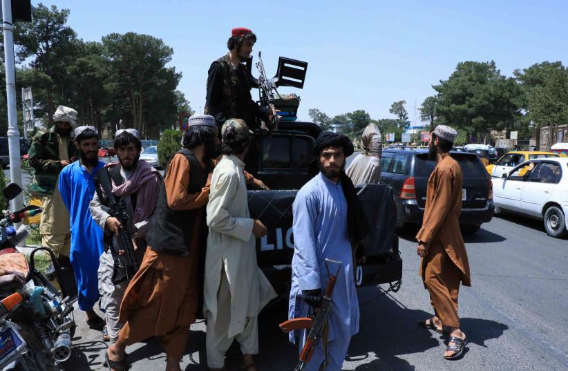 TALIBAN FORCES patrol a street in Herat, Afghanistan, August 14, 2021 (credit: REUTERS/STRINGER)