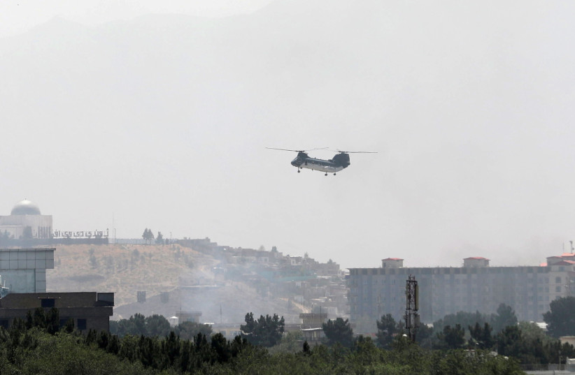 CH-46 Sea Knight military transport helicopter flies over Kabul, Afghanistan (photo credit: REUTERS/STRINGER)