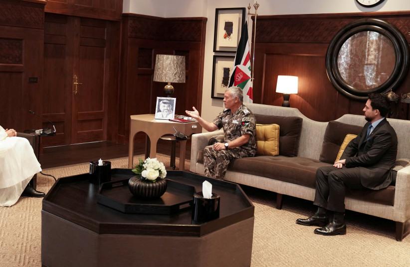 Jordan's King Abdullah II and Crown Prince Hussein meet with Qatar's Foreign Minister Mohammed bin Abdulrahman bin Jassim Al Thani, in Amman, Jordan August 16, 2021. (credit: JORDANIAN ROYAL PALACE/REUTERS)