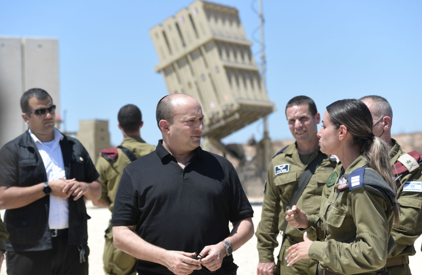 PM Naftali Bennett at a situation assessment tour of the Gaza Division at the Iron Dome battery, August 17, 2021 (photo credit: KOBI GIDON / GPO)