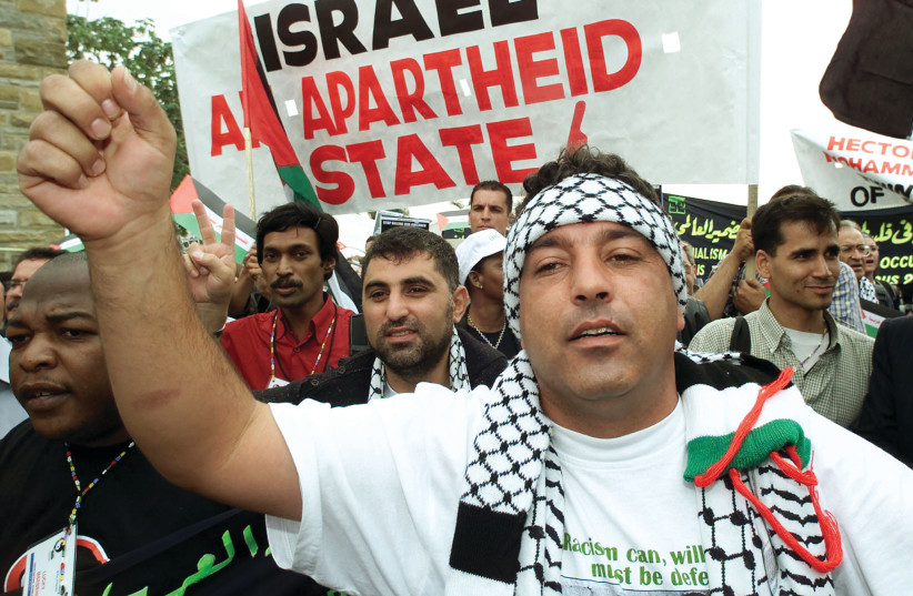 PRO-PALESTINIAN SUPPORTERS demonstrate outside the World Conference Against Racism in Durban, South Africa, in 2001. (credit: REUTERS)