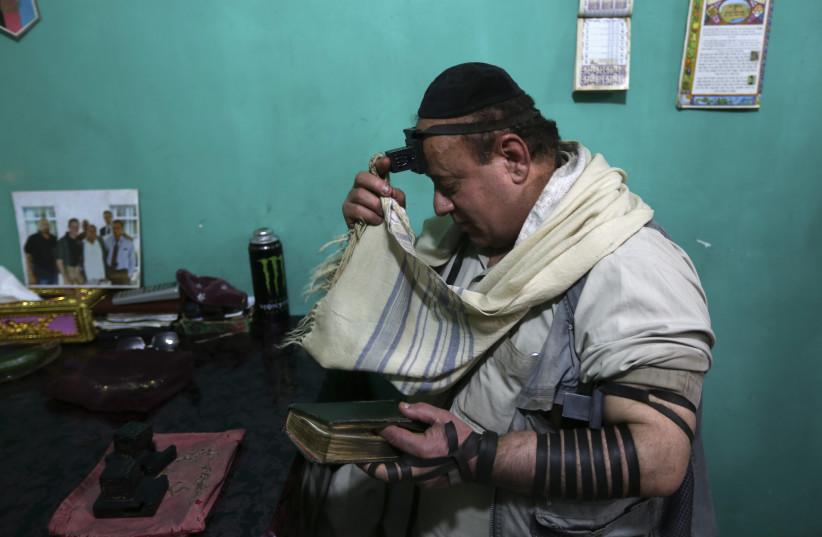 Simantov, an Afghan Jew, prays at his residence in Kabul (photo credit: REUTERS)