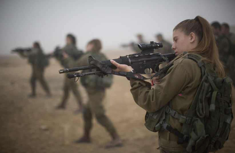 Soldiers of the Bardales Battalion prepare for urban warfare training on an early foggy morning, near Nitzanim in the Arava area of Southern Israel, on July 13, 2016. Formed in 2014, the Bardales Battalion is an infantry combat battalion of the Israel Defense Forces, composed of 50% female soldiers (credit: HADAS PARUSH/FLASH90)