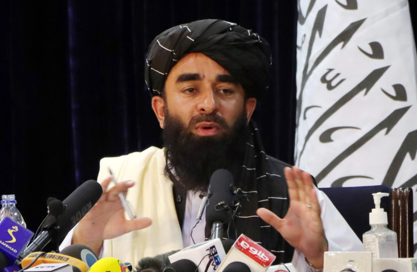 Taliban spokesman Zabihullah Mujahid speaks during a news conference in Kabul, Afghanistan August 17, 2021. (credit: REUTERS/STRINGER)