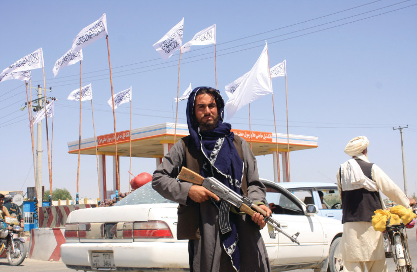 A TALIBAN fighter inside the city of Ghazni, Afghanistan, last weekend. (photo credit: REUTERS/STRINGER)
