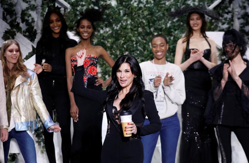 DESIGNER JULIA Haart appears with models during New York Fashion Week in Manhattan in 2017. (photo credit: BRENDAN MCDERMID/REUTERS)