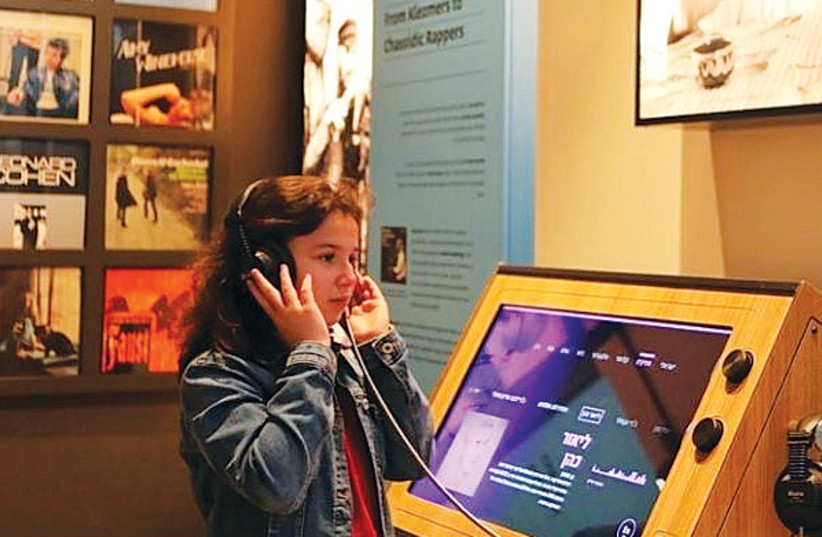 A YOUNG VISITOR at the Anu – Museum of the Jewish People discovers her roots. (credit: Courtesy)