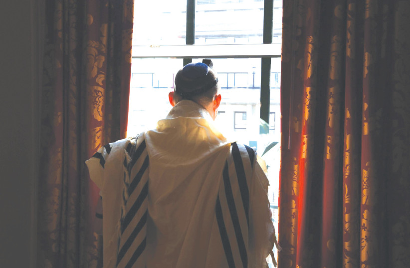 Prime Minister Naftali Bennett praying at the Willard Hotel in Washington on Wednesday. (photo credit: AVI OHAYON - GPO)