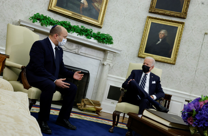 US President Joe Biden and Israel's Prime Minister Naftali Bennett chat during a meeting in the Oval Office at the White House in Washington, US (credit: JONATHAN ERNST / REUTERS)