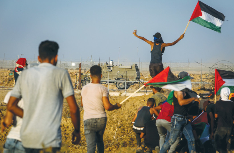 PALESTINIAN PROTESTERS clash with IDF forces during at the Israel-Gaza border east of Khan Yunis last week.  (credit: ABED RAHIM KHATIB/FLASH90)