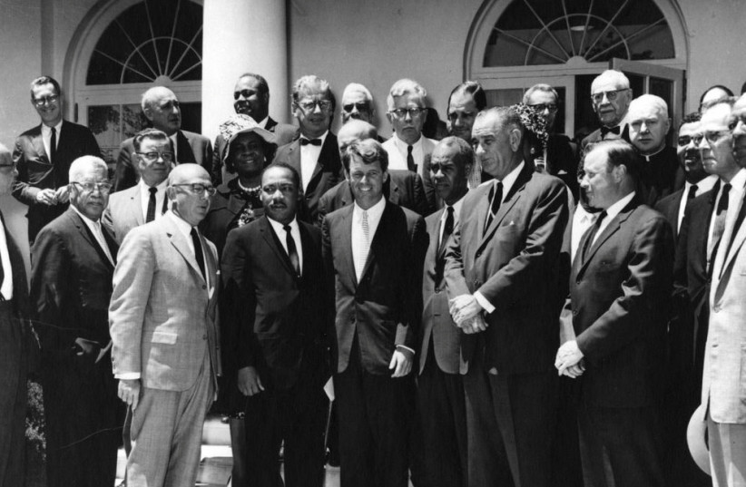 Attorney General Robert F. Kennedy meets with civil rights leaders, including Dr. Martin Luther King Jr., in the Rose Garden of the White House, Washington, D.C., June 22, 1963 (credit: Abbie Rowe, National Parks Service/JFK Presidential Library and Museum/Handout via REUTERS)