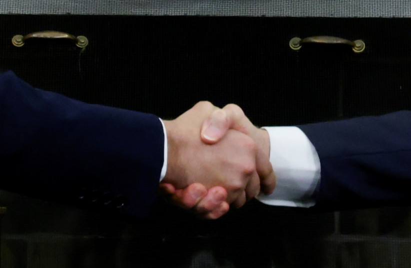 US President Joe Biden and Israel's Prime Minister Naftali Bennett shake hands during a meeting in the Oval Office at the White House in Washington, US August 27, 2021. (credit: REUTERS/JONATHAN ERNST)