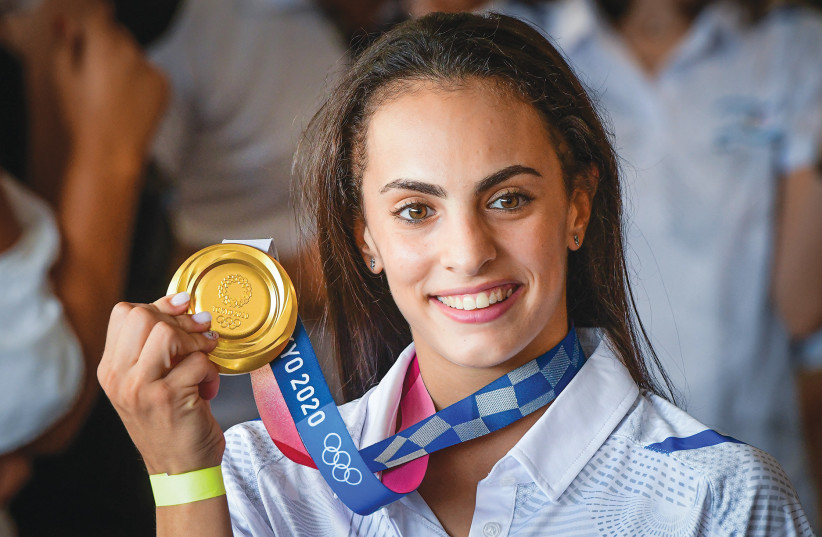OLYMPIC GOLD medalist Linoy Ashram is greeted by family and friends as she arrives at Ben-Gurion Airport earlier this month (credit: AVSHALOM SASSONI/FLASH90)