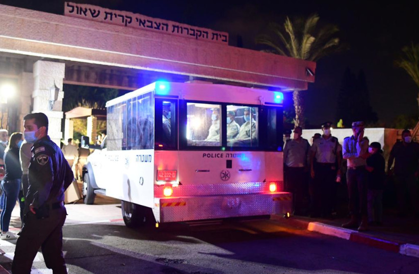 Israel Police car carrying the body of Border Police St.-Sgt. Barel Hadaria Shmueli died from his injuries on Monday following gunshot wounds inflicted on his by a Palestinian gunman during Gaza border riots, August 30 2021.  (credit: AVSHALOM SASSONI/MAARIV)