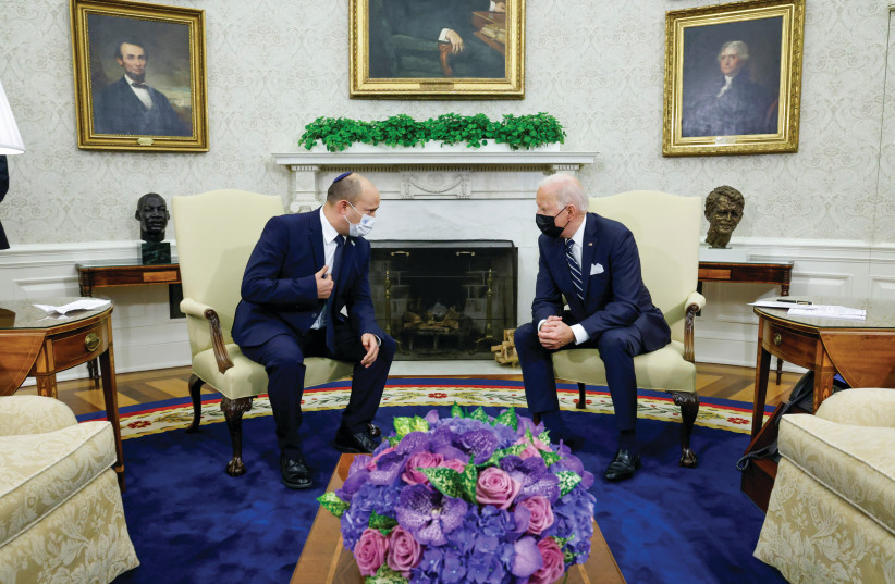 PRIME MINISTER Naftali Bennett and US President Joe Biden chat in the Oval Office last week. (credit: JONATHAN ERNST / REUTERS)