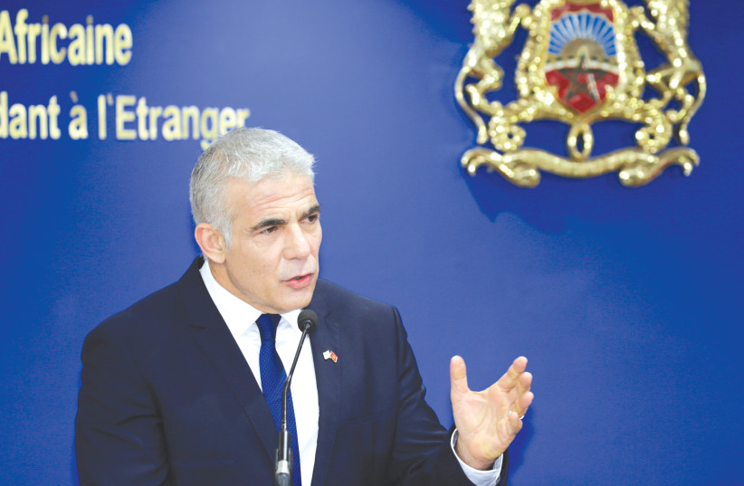 FOREIGN MINISTER Yair Lapid speaks at a news conference in Rabat, Morocco, last month (photo credit: YOUSSEF BOUDLAL / REUTERS)